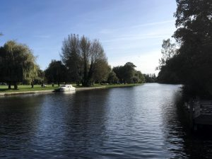 Photo of River Avon with boat and greenery