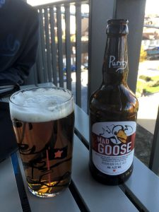Photo of a glass of beer and Mad Goose bottle