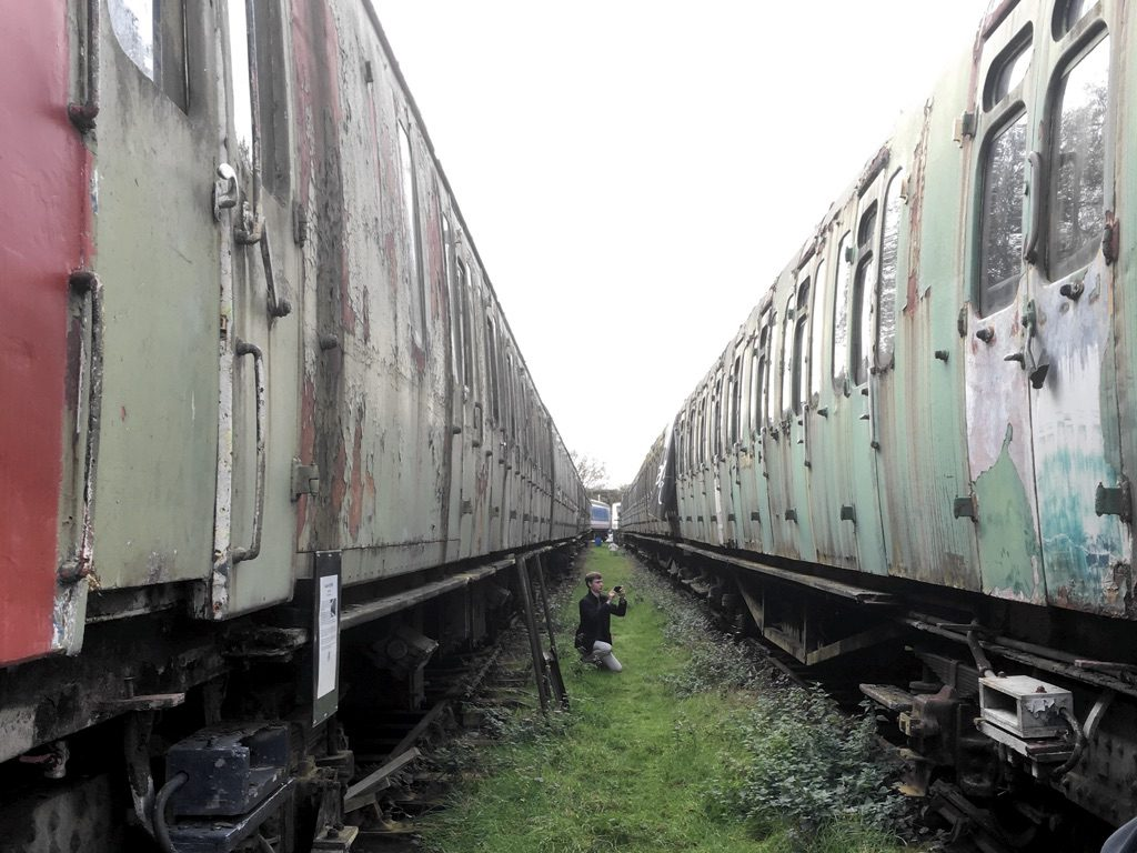 Photo of two dilapidated railway vehicles at Electric Railway Museum