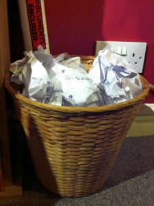 Waste Paper Basket with discarded homework in it