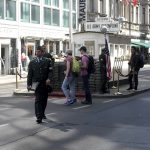 Tourists outside Checkpoint Charlie