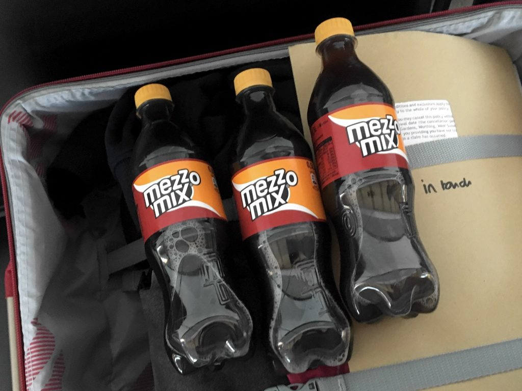 Mezzo Mix bottles in a suitcase