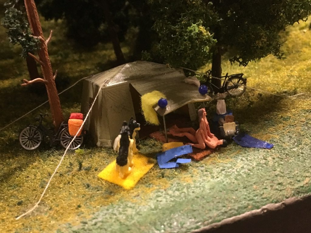 Model of a couple getting amorous while camping