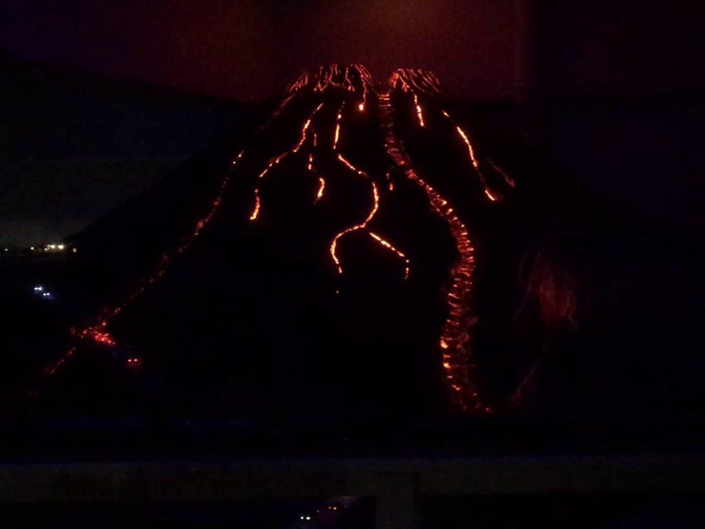 Model of Volcano in the dark, with glowing simulated lava flows