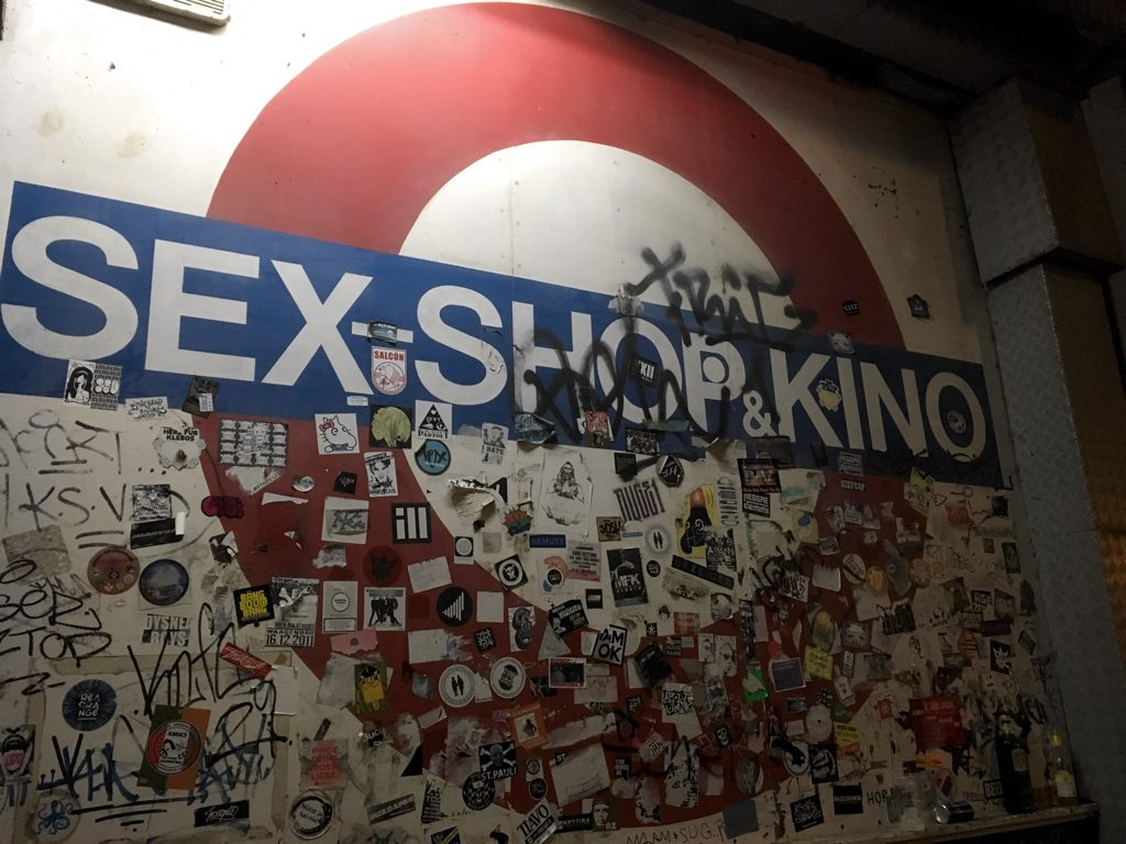 "London Underground style roundel with sign ""Sex Shop & Kino"""