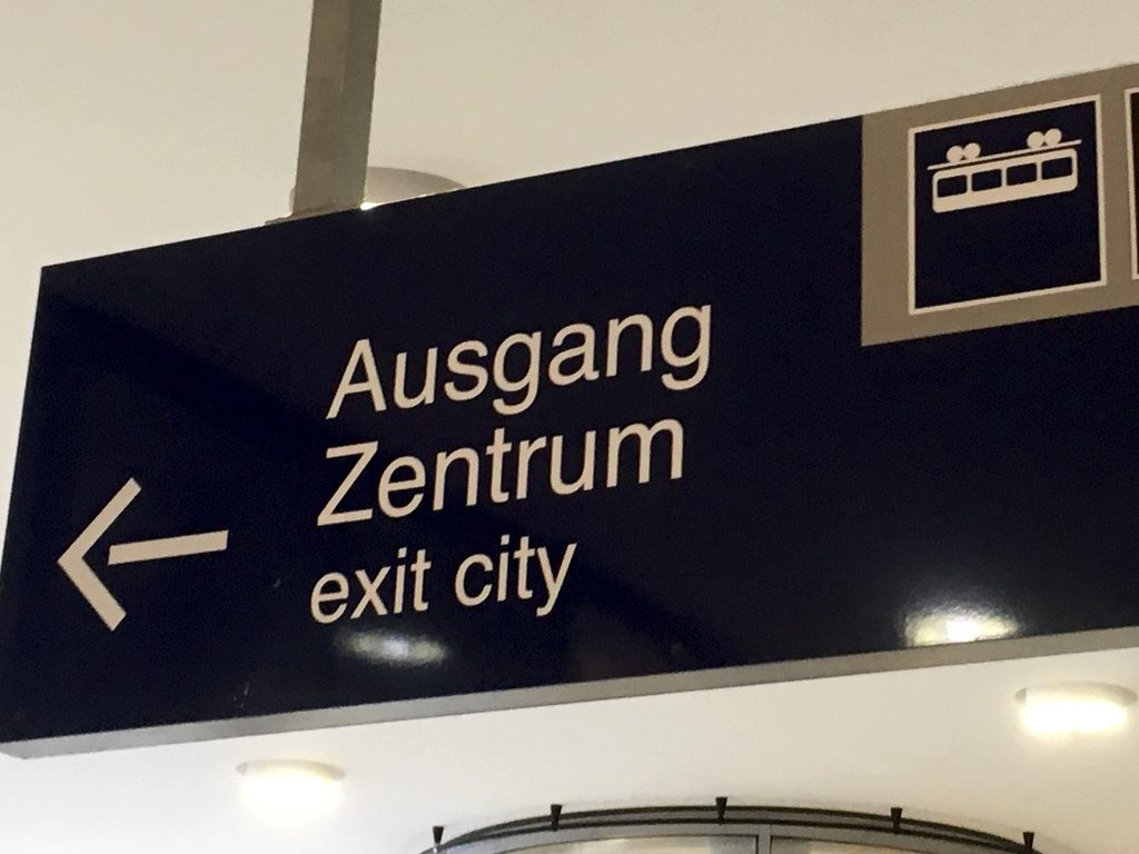 "Sign pointing to ""Ausgang"" (exit) with Schwebebahn symbol"