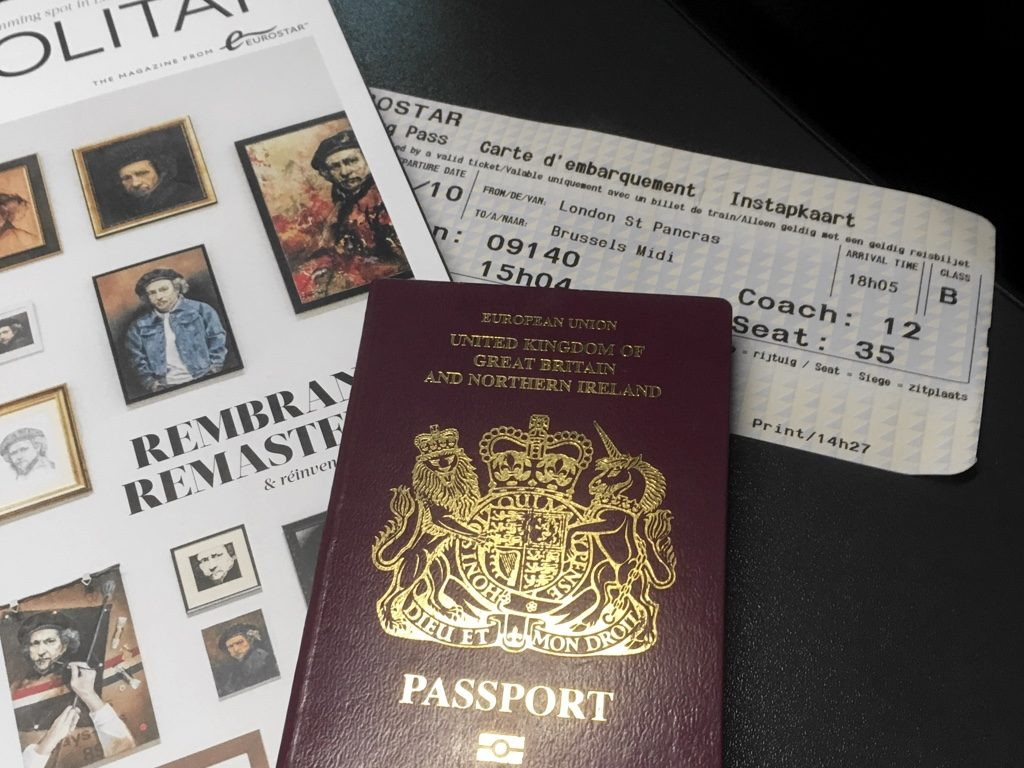 Photo of Metropoilitan magazine with boarding pass and passport
