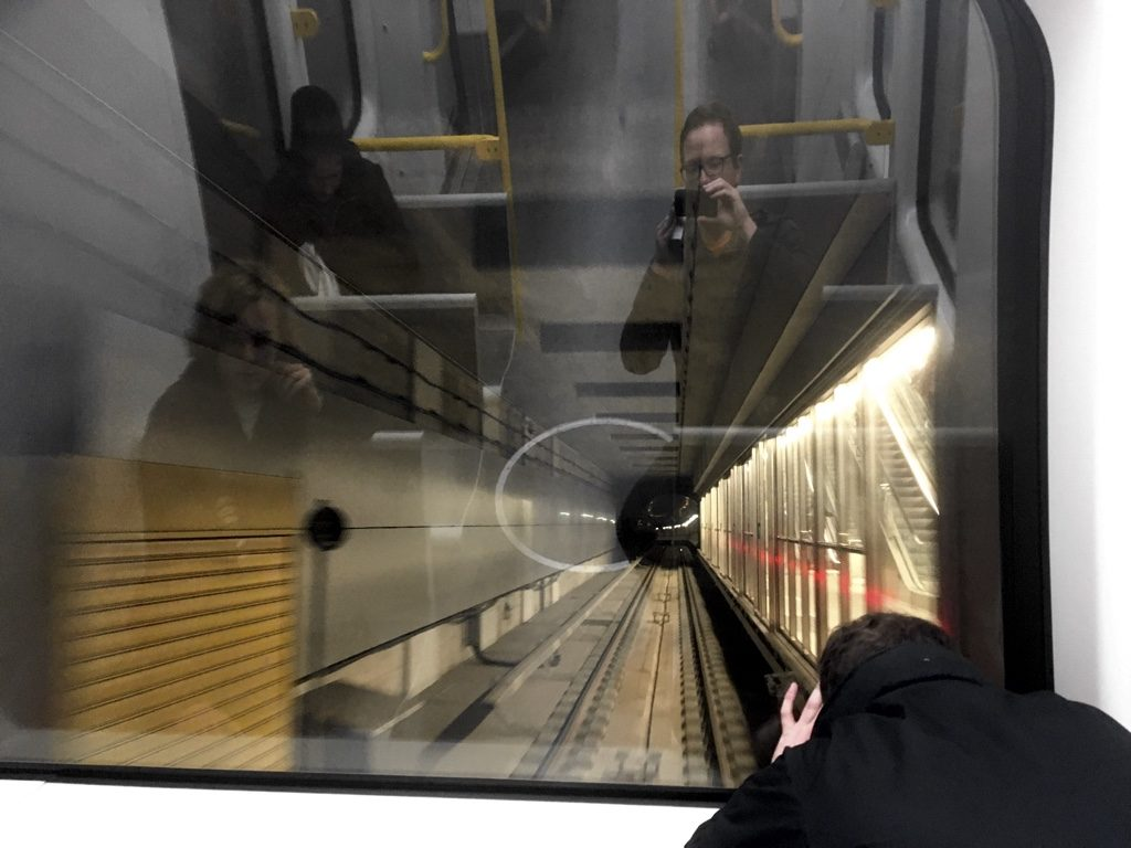 View from the rear window of Copenhagen Metro train, showing tunnel