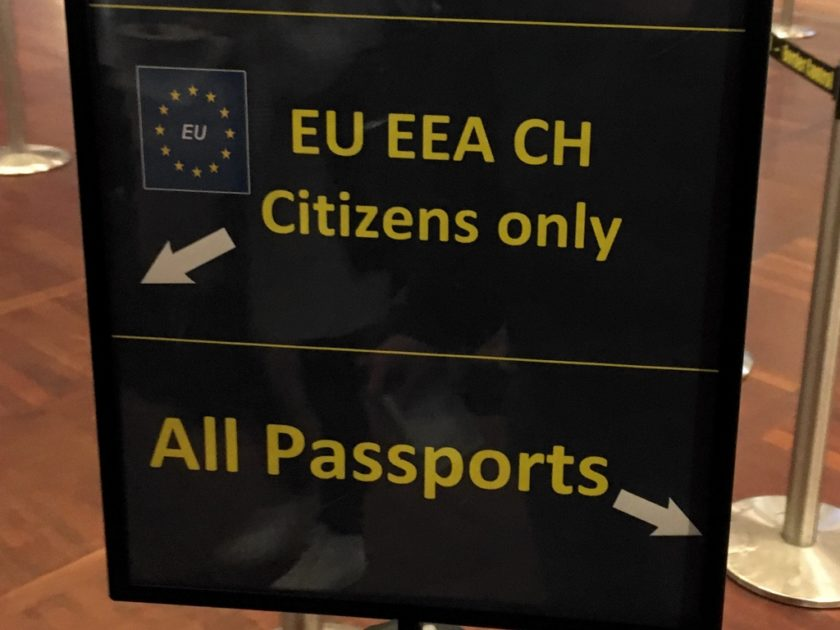 """Sign pointing to the left for """"EU EEA CH Citizens only"""" and to the right for """"All Passports"""""""