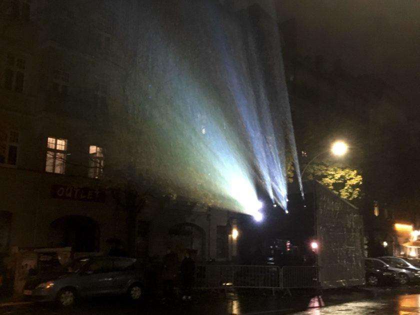 Projector beam illuminating rain