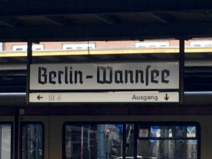 "Photo of sign reading ""Berlin-Wannsee"" in fraktur font"