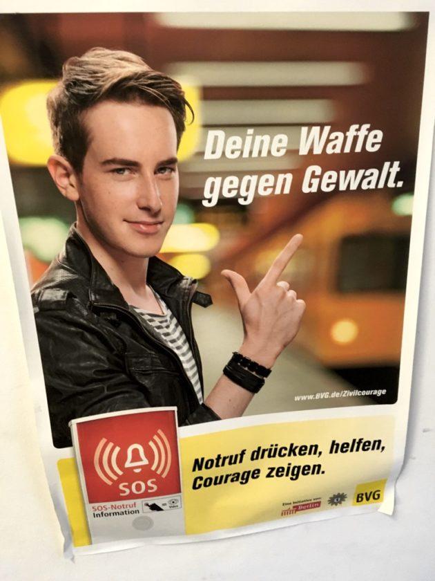 """Poster of man pointing, with slogan """"Deine Waffe gegen Gewalt"""""""