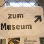 "Sign reading ""zum Museum"" with arrow pointing"